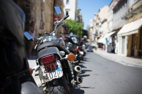 Motorcycles line the street in Plaka